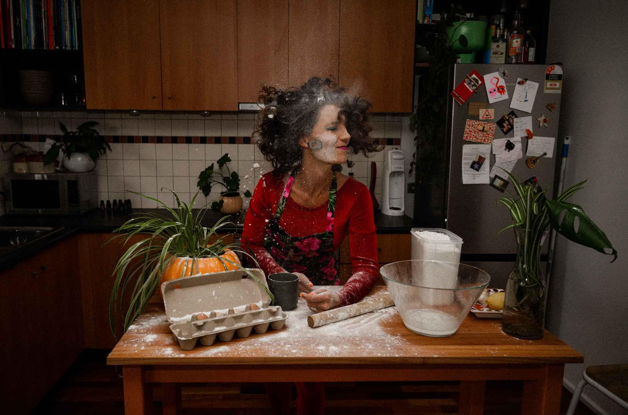 Photo of Xani in kitchen baking with flour everwhere